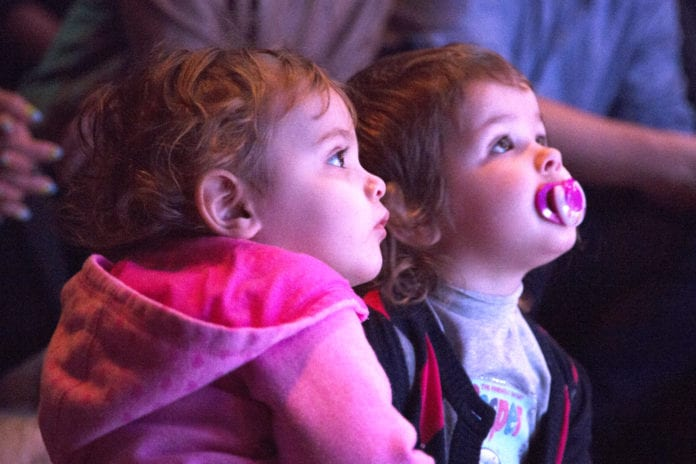 Children captivated by a performance