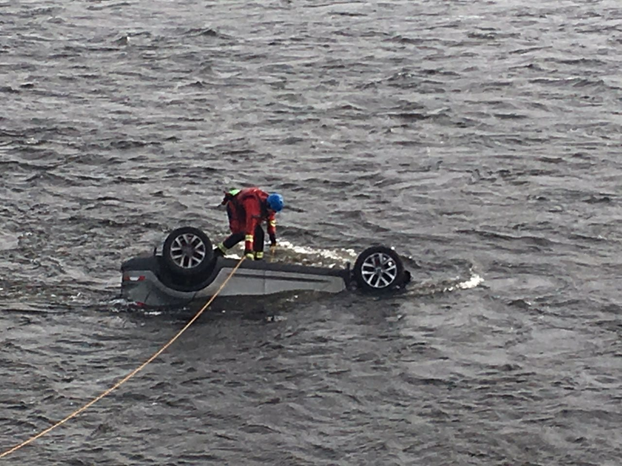 Man rescuing car from the Corrib