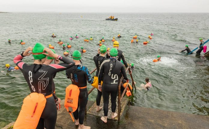 Galway Daily sport 130 people swimming Galway Bay for Cancer Care West