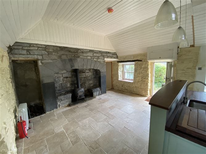 Picturesque cottage is an exciting renovation opportunity